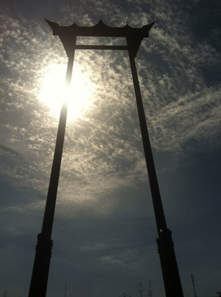 The giant swing in Bangkok with clouds senset